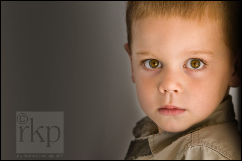 Boy staring wide eyed into the camera lens