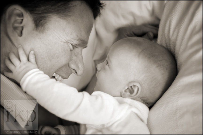 Baby and Father close up in bed