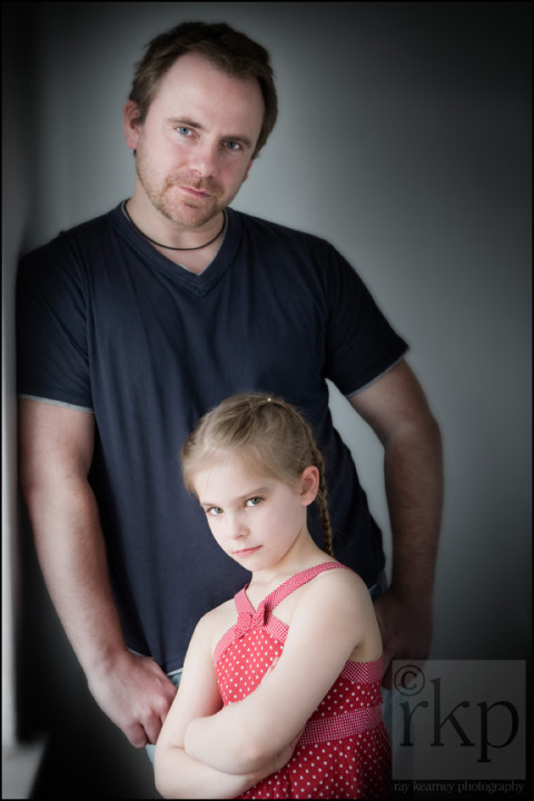 Father and daughter by a window