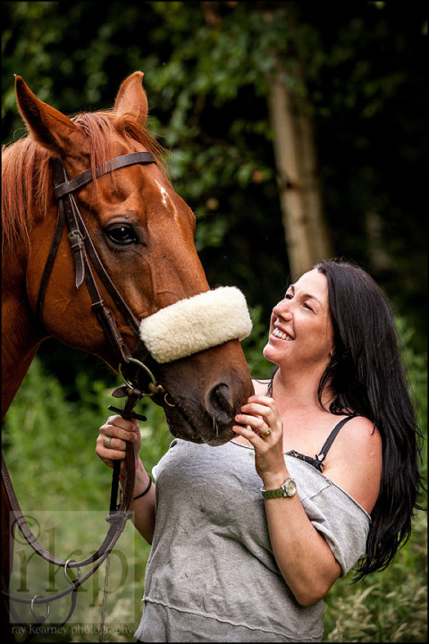 Woman laughing with her horse