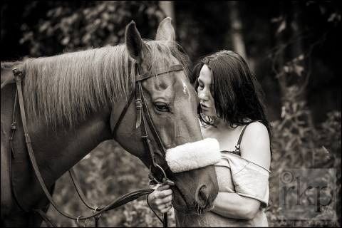 Woman whispering to her horse