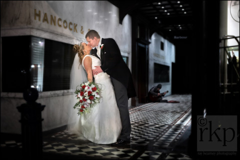 Bride and Groom in the rain, King Street, Manchester