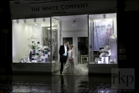 Bride and Groom in the rain at night, Manchester