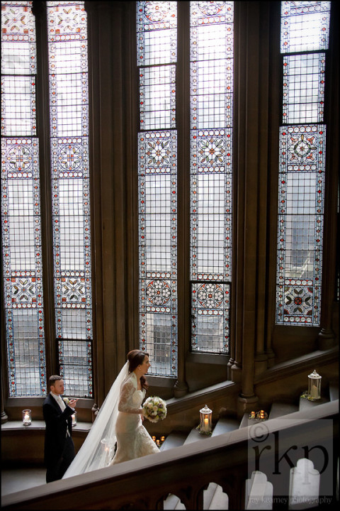 Bride and Groom walking up the stairs, Manchester Town Hall