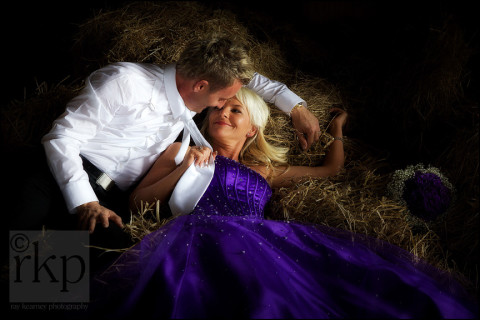 Bride and groom in the hay at Sandhole Oak Barn
