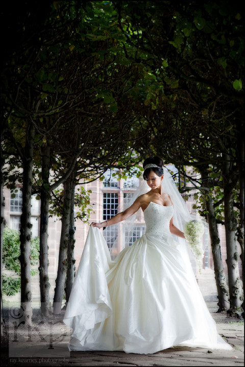 Bride holding dress at Thornton Manor