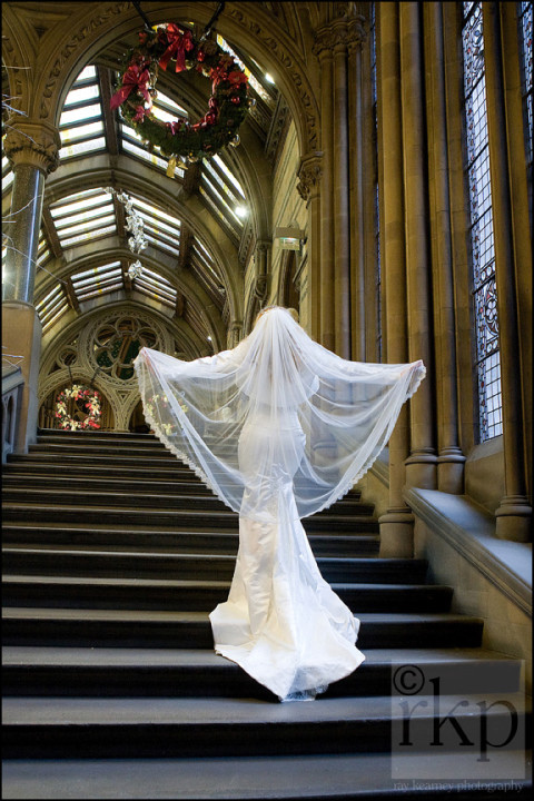 Bride walking up the stairs, Manchester Town Hall
