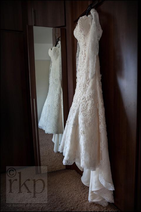 Bridal dress hanging on wardrobe