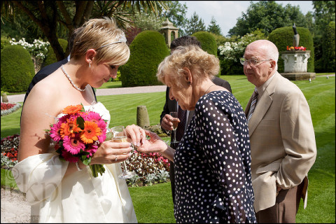 Guest admiring the Bride's wedding ring at Soughton Hall