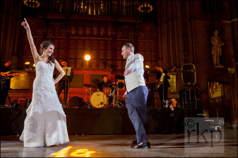 Bride and Groom have their first dance in front of the band, Manchester Town Hall