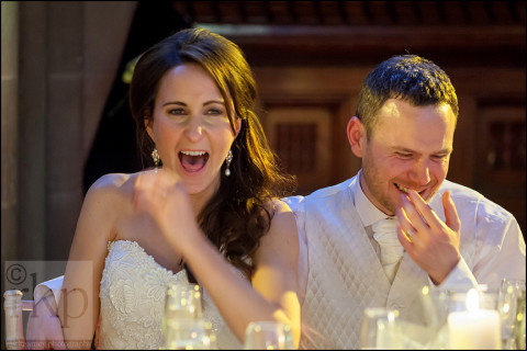 Bride and groom enjoying the speeches, Manchester Town Hall