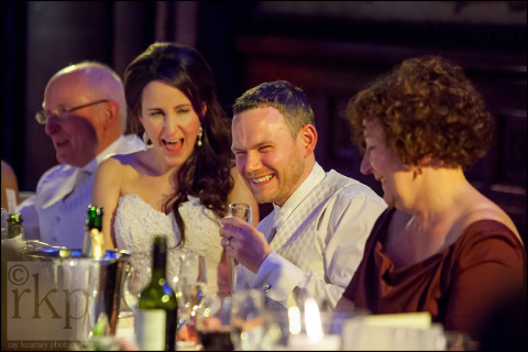Bride and groom laughing during the speeches, Manchester Town Hall