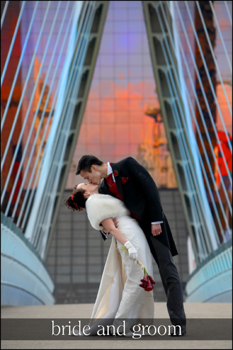 Bride and Groom kissing on a bridge at The Lowry Centre, Salford